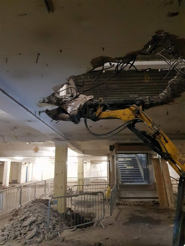 Brokk machine removing section of roof slab to  create atrium openings to Mark & Spencer, Grafton Street